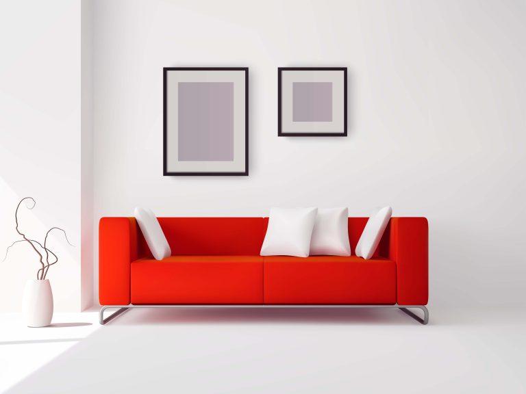 白を基調とした部屋にある赤ソファのイメージ画像