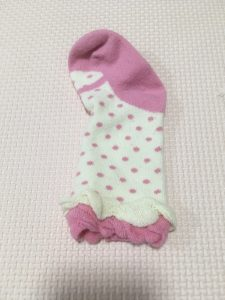 赤ちゃん用のピンクの靴下の写真